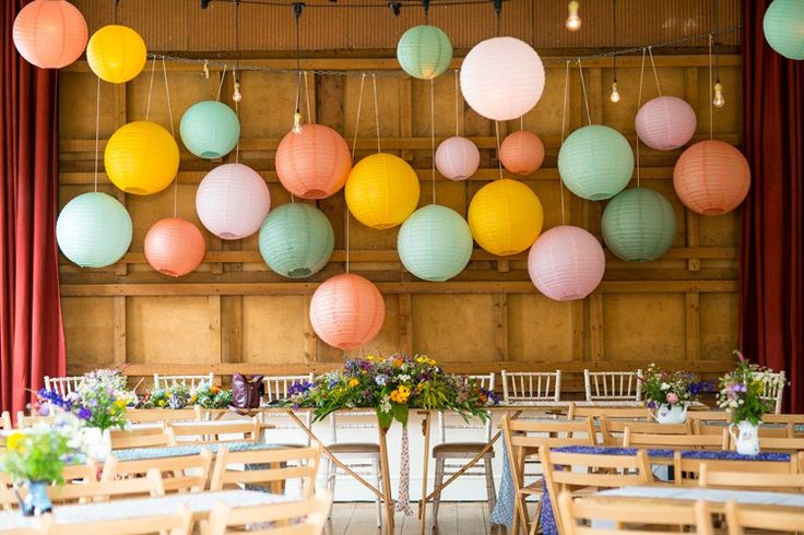 Lantern Backdrop Wild Flowers Colourful DIY Village Hall Wedding http://samanthagilrainephotography.com/