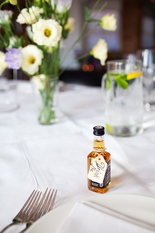 """Planning on having a miniture bottle of jack daniels and a shot glass as our wedding favours. I like thd idea of writing the guest's name on one side of the luggage tag, and """"first nip"""" on the other side."""