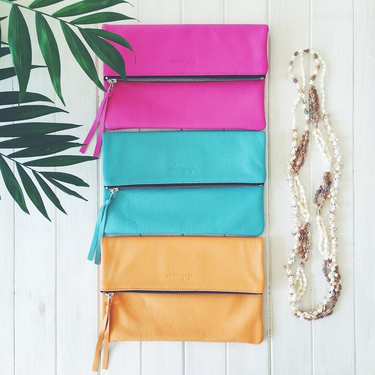 Handcrafted luxe leather foldover clutches in gorgeous summer tones.