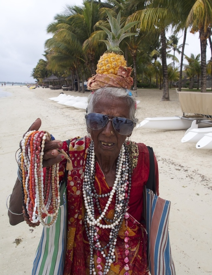 See this lady, I used to buy fruits off her when I was a kid on Trou aux Biches beach. No kidding.