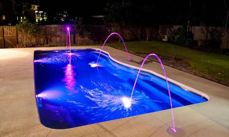 A Moroccan Style Fiberglass Pool with lighted Laminar Jets