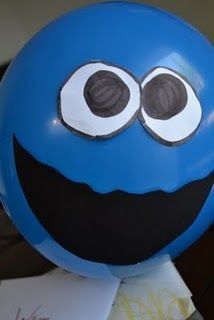 Cookie Monster Party.. could use red balloons to make elmo too :)