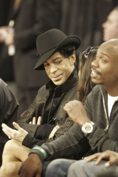 Prince in a hat with friend and Dave Chappelle at a #SportingEvent