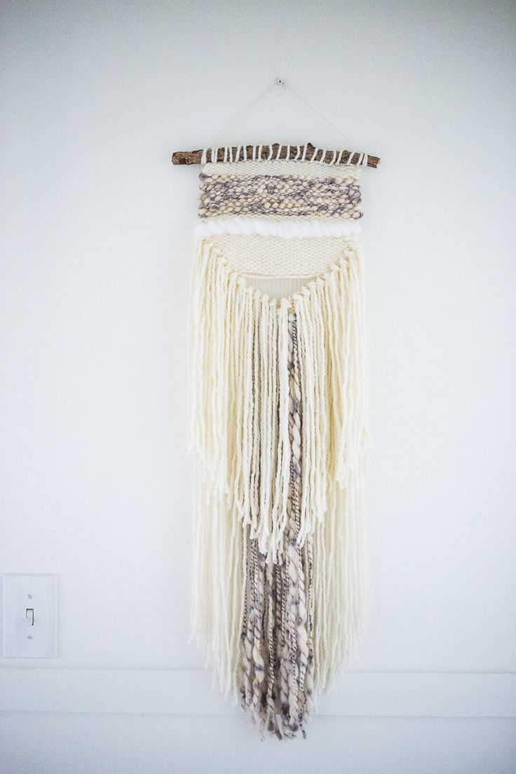 This beautiful long yarn weaving is intricately woven on a loom using specialty Lamb's Wool yarns, vegan yarns (Acrylic), and cotton yarn. The tapestry is secured to a natural tree branch. Length: App