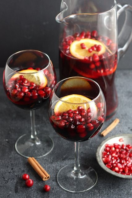 Pomegranate and Orange Sangria | A winter red wine sangria with pomegranates and oranges, as well some cranberries, a cinnamon stick and a heavy splash of brandy.