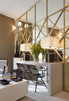 Modern Interior Design #MirrorWall, Contemporary Interior Architecture.  How to make a small room look larger.  Use simple square mirrors or wood molding applied over large mirrors.