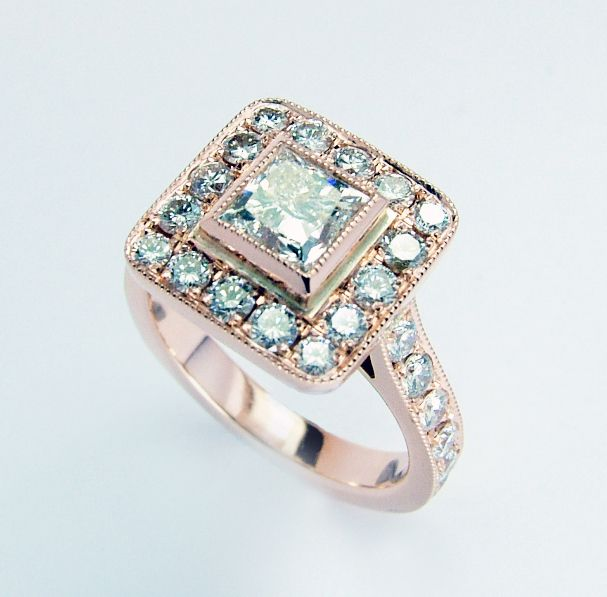 """And finally complete.....A """"Halo"""" style engagement ring in Rose gold set with a princess cut diamond and little brilliant cut diamonds. jewelled.co.uk"""