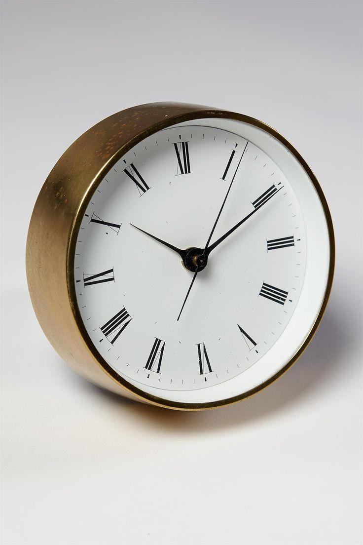Henning Koppel; Brass and Enameled Steel Wall Clock for Louis Poulsen, 1950s.
