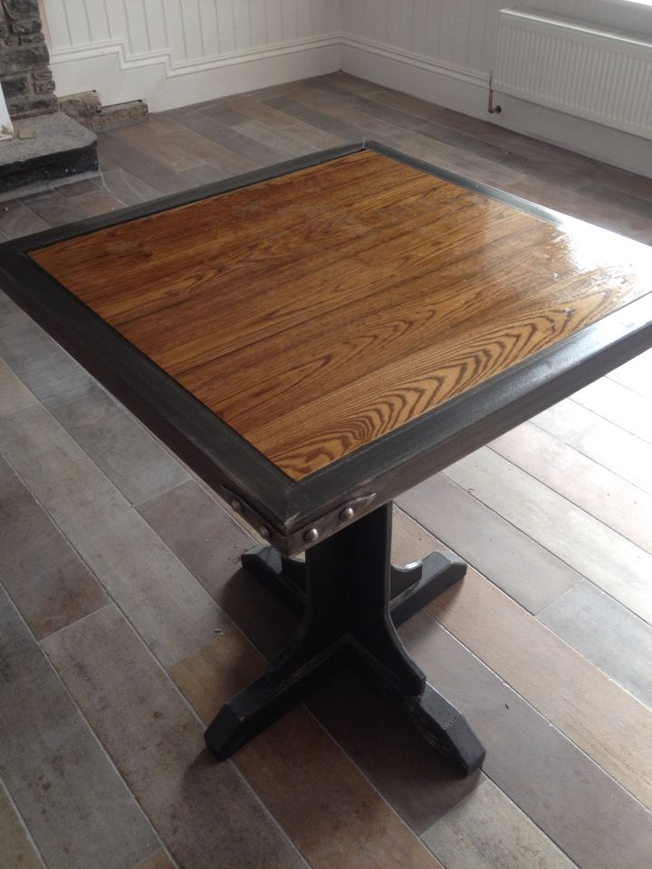 Solid ash table with a forged cold steel surround. Came out well