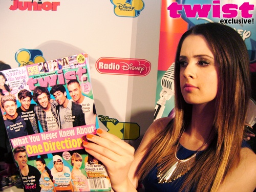 laura marano catching up on all the latest celeb gossip in the march issue of twist