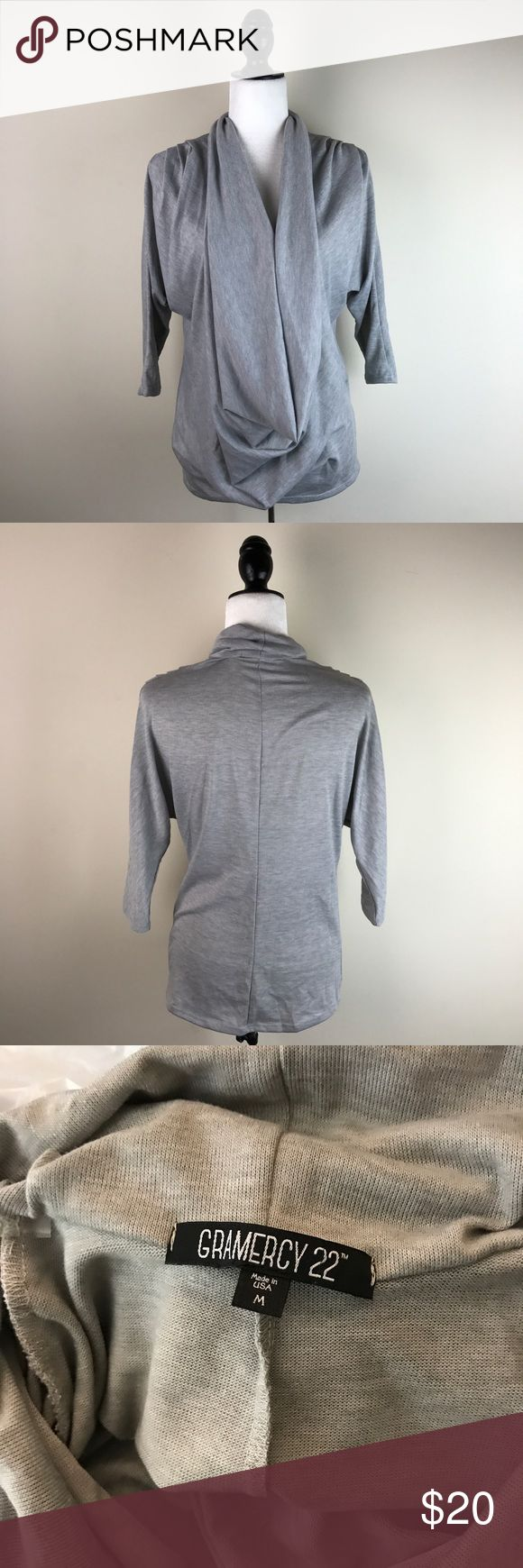 """Gramercy 22 Grey Slouchy Top Love the slouchy oversized look of this top. Please see the photo of it from the side to see how much fabric it is. It drapes in the front. Has a small pick on the front of the shirt, but it is hidden by the drape when worn. So cute! Gently used with no other flaws. 82% polyester, 14% rayon, 4% spandex.   Measurements laying flat (without stretching)— Armpit to armpit: 19"""" Length, shoulder to hem: 26"""" Gramercy 22 Tops"""