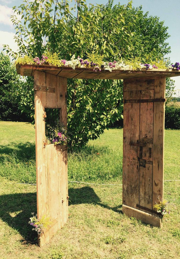 Old doors background arch for an outdoor summer wedding