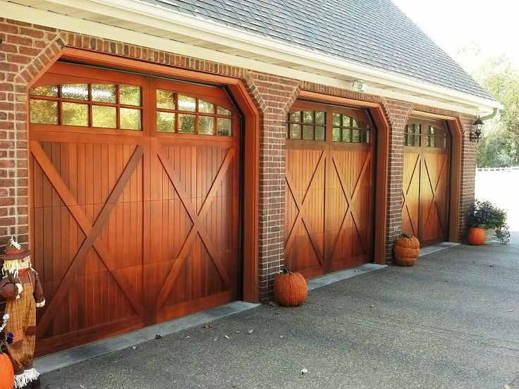 @C.H.I. Overhead Doors model 5434A Wood Carriage House Style Garage Doors with Overlay & Arch Stockton Glass