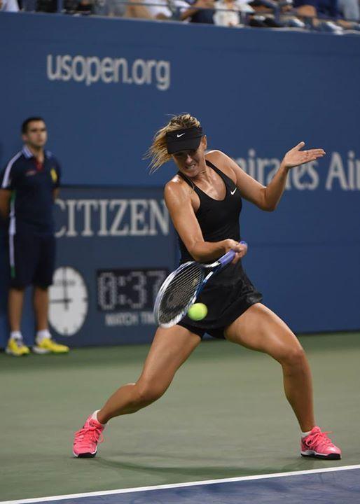 Maria Sharapova, of Russia, returns a shot to Maria Kirilenko, of Russia, during the opening round of the U.S. Open tennis tournament Monday, Aug. 25, 2014, in New York. #WTA #Sharapova #USOpen