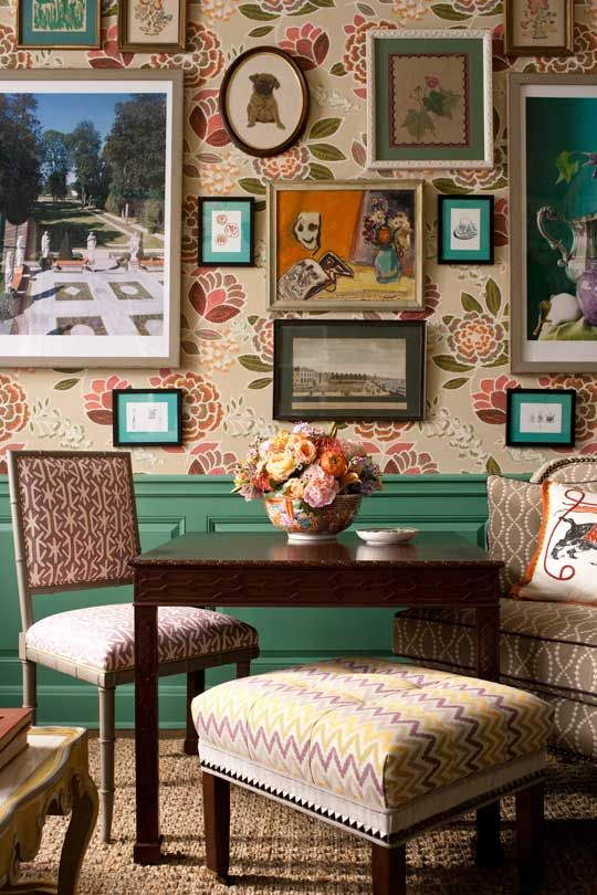 A mix of vintage and contemporary art fills a wall in the breakfast room. Who says that your frames have to match: Mix wood with painted treatments with gilt. And have fun with your matting and sizes. We especially love the vintage needlepoint of the pug that looks just like Weenie. The upholstered pieces are all from @thibaut_1886; the card table is an antique that we later sold on @onekingslane.