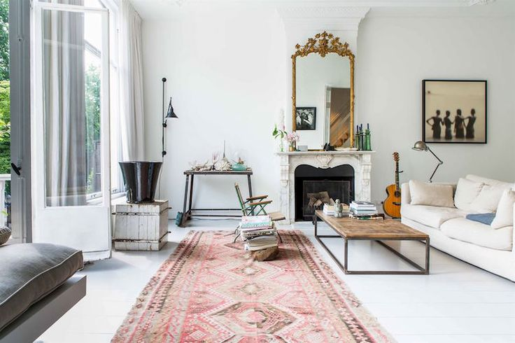 All-white livingroom with the prettiest blush carpet and big windows.