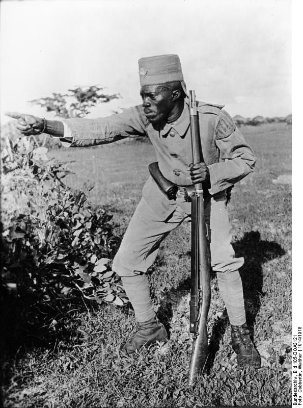 An African Askari Soldier serving the German Army preparing to engage during the outbreak of WW1, 1914