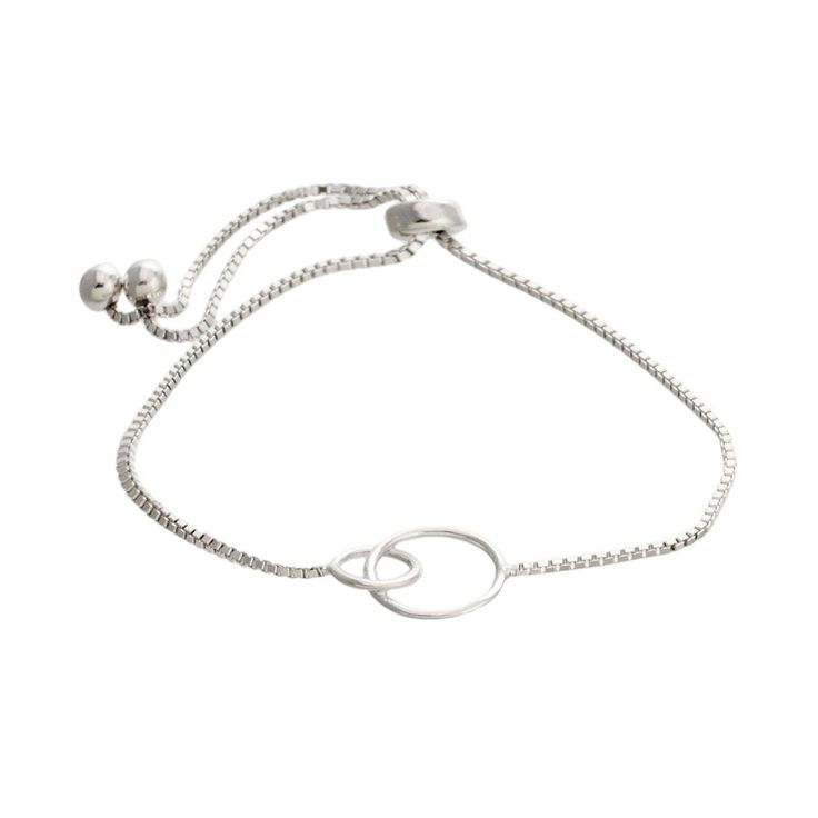 This trendy bracelet is accented by a intertwining open circle design in the center. For just the right fit, simply adjust the bracelet by sliding the bead up a