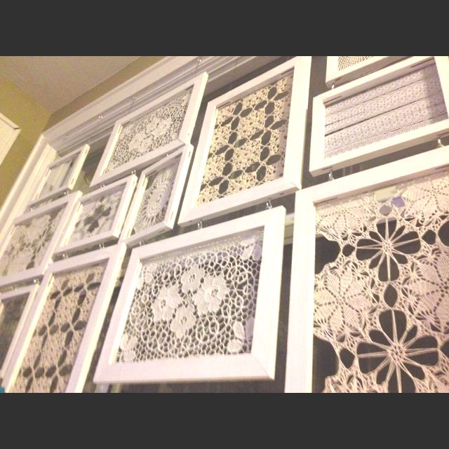 Frame Grandma's doilies in between glass and display above changing table.