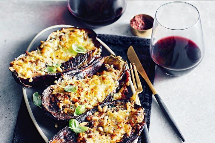 Eggplants stuffed with haloumi, basil and pine nuts