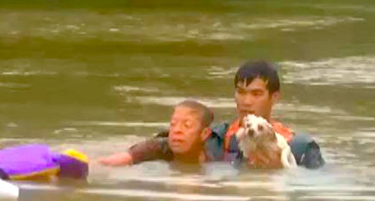 WATCH: Rescuers pull Louisiana woman and her dog from sinking car during deadly flood