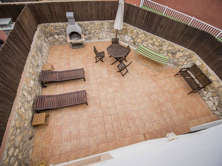 - View down (from roof top solarium) to large rear terrace with BBQ and sunbeds
