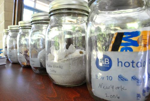 VACATION JARS! Simple fifty cent canning jars become charming time capsules when you fill them with items that you've collected on each journey and label them with the location and date written on a piece of clear tape in the front of each one.