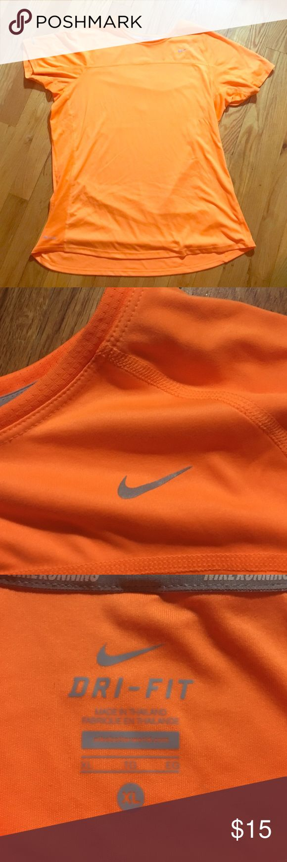 Nike women's running top. Authentic Nike women's running top. Color is orange and size is XL. Great for night runs and bold personalities! Dri-Fit material keeps you cool while running. Nike Tops Tees - Short Sleeve