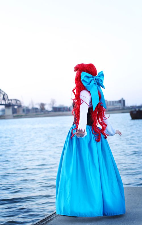 Ariel, The Little Mermaid.. Bridal shower! I would enter as the mermaid version, and then something intense would happen where I leave and come back as this Ariel!