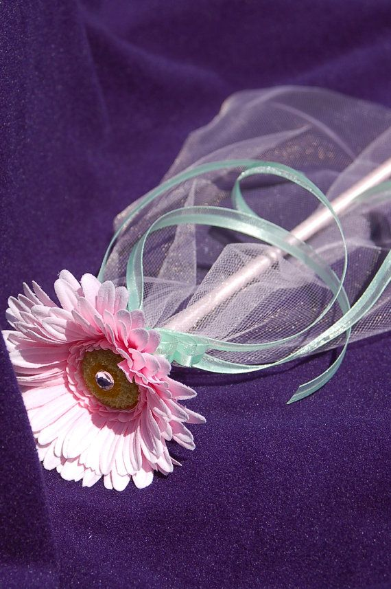 cute idea- can present the party-goers with flower and a wand!  easy to make with flower, ribbons, tulle, floral tape