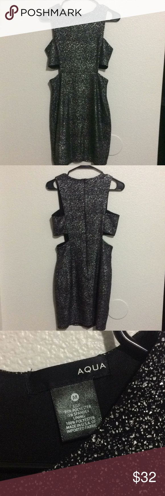 AQUA from Bloomingdales black bodycon dress AQUA from Bloomingdales black silver metallic bodycon dress with side cut outs.   Size Medium. Has stretch.   Worn one time. Aqua Dresses Midi
