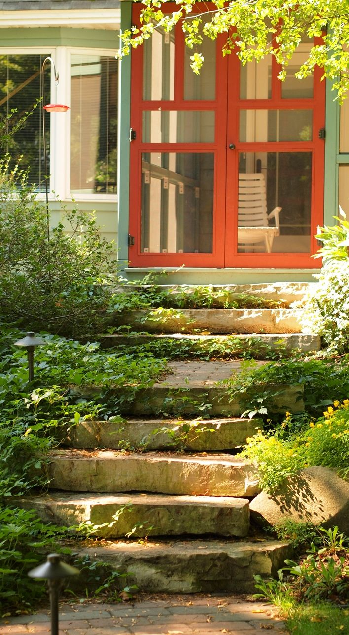 The natural stone steps of a stairway garden feature climb a small - Beautiful Front Entry Natural Stone Steps Chilton Outcropping Step
