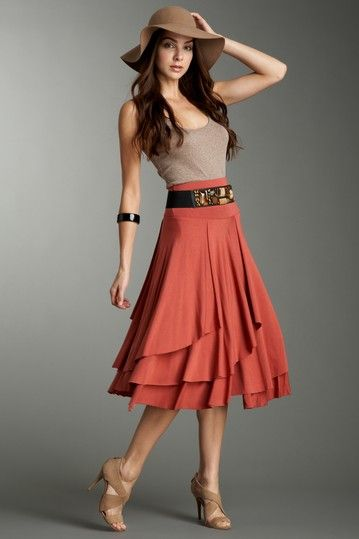 Love the skirt! Cover up the top to be modest.