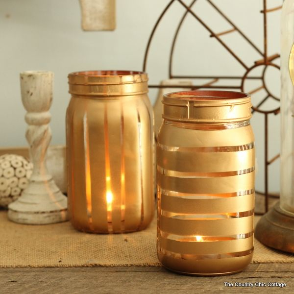 Learn how to make painted jars quickly and easily. These metallic painted jars use rubber bands for masking stripes both horizontal and vertical.