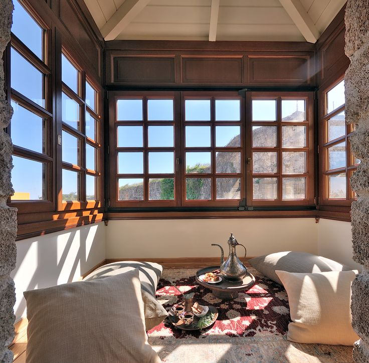 """EXCLUSIVE SUITES BOUTIQUE HOTEL. MEDIEVAL TOWN, RHODES, GREECE. -  Deniz suite:  """"Sahnisi"""",  the enclosed wooden balcony has a view of the sea over the roof tops and the surrounding wall of the Old Town. - kokkiniporta.com"""