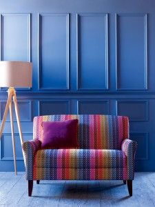 The #blue stripes on this multicoloured sofa look spectacular against the matching backdrop