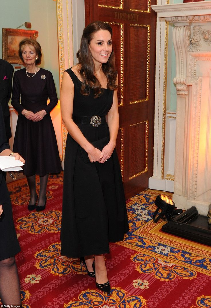 The Duchess wore a black cocktail dress by Preen with a bejewelled belt and vertiginous bl...