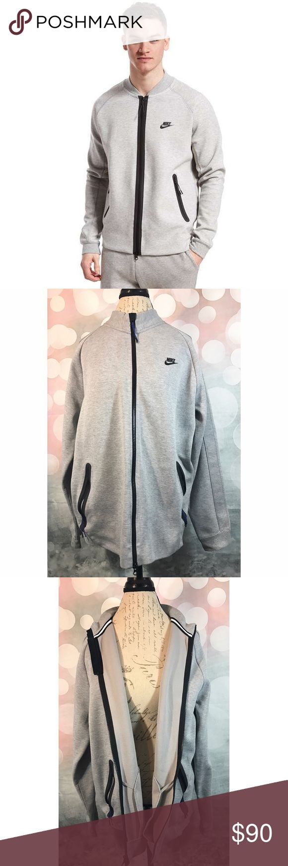 """Men's Nike Tech Varsity Jacket Grey Zippered XL An amazing piece from Nike, their higher quality items, Nike Tech Fleece. The style is: Varsity Jacket. Color is grey and features an opened Zippered front and two side pockets. Size XL. Item is lightly worn and in amazing condition, with only noted """"flaw"""" being small fading on top zipper portion, as pictured, nothing major.   Additional Information:  Made in: China  Material: 66% cotton, 34% Polyester Nike Tech Sweaters Zip Up"""