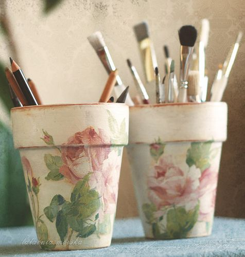 Terra cotta pots - painted white, distressed a bit, decoupaged with rose printed paper napkins