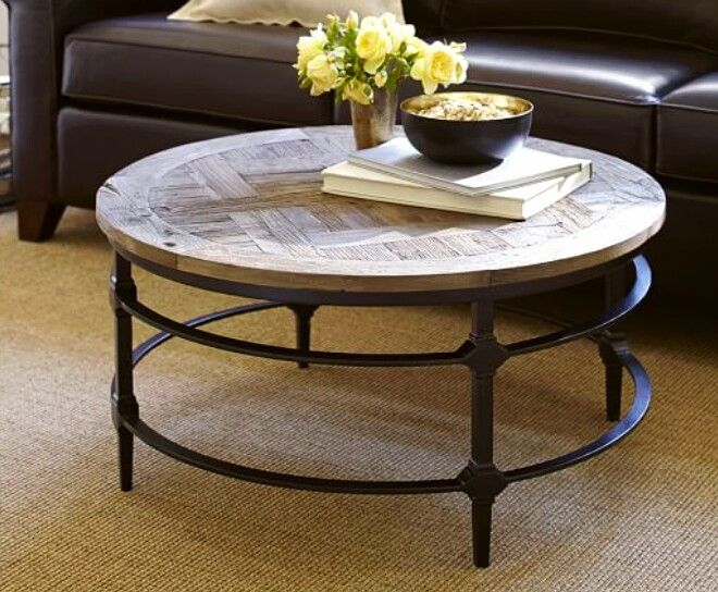 Reclaimed Wood and Iron Round Coffee Table. Pottery Barn.