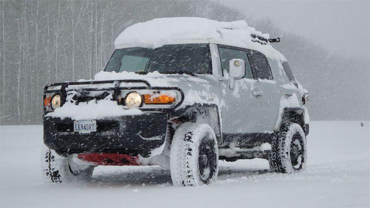 FJ cruisers in the snow,
