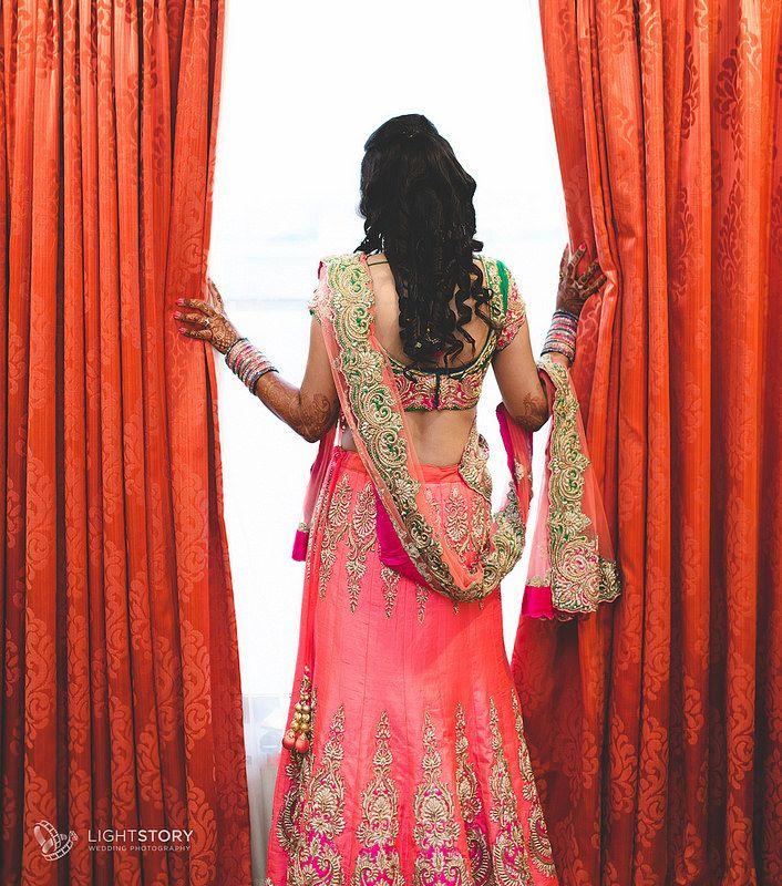 To a new beginning | Sensational Lehenga | Bride watching through the window | Weddings by Light Story | www.lightstory.in