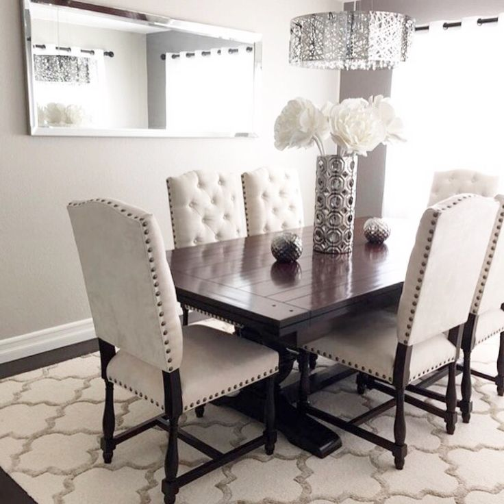 Table and chairs Our Montecito Collection merges traditional and formal in dining  room. Also styled with our Axel Vase.