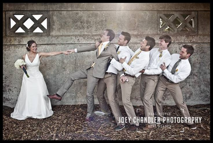 Groomsmen won't let go - what a great photo to capture!