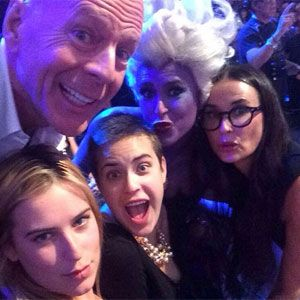 Bruce Willis and Demi Moore pose for a rare family photo with their daughters!