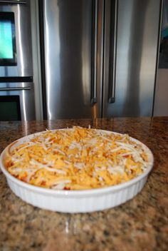 My Favorite Dip Ever.. Spread 1- 8oz pkg of cream cheese into an a round or 8x8 square dish. Top with 1 1/2 cups of your favorite salsa. Sprinkle on finely chopped green onion and 2 medium size diced tomatoes. Top with grated cheddar cheese (or blend of nacho cheese mix pre-grated from the store) Bake in a 350degree oven for 30 minutes or until bubbly. Serve with taco chips or scoops. My friends call this molten hot deliciousness and they make me bring it to all of our get togethers :)
