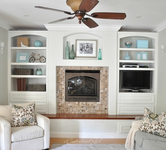 """like the soft arch's in built ins & bench seating in front of fireplace that runs the width of room especially in such a """"squared""""  space... both soften the area."""