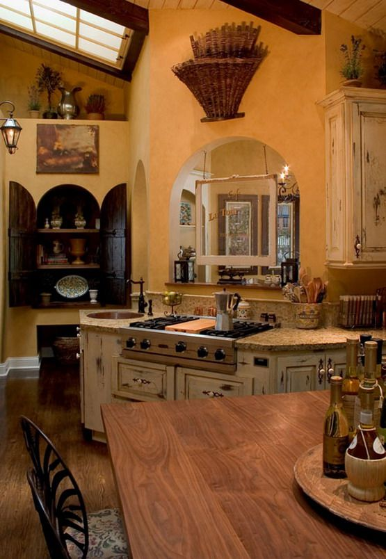 The color of the walls plus the unusual black cabinet and the movement of the walls is what I like here.  Arches are great.  I don't really like the cabinet wood, but it works here: