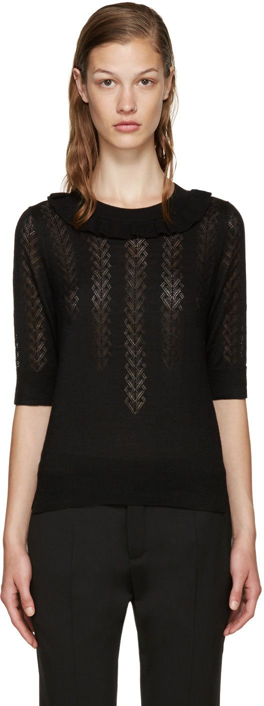 Short sleeve wool and silk-blend sweater in black. Open-knit lace detailing throughout. Rib knit at crewneck collar, cuffs and vented hem. Ruffle accent at collar. Tonal stitching.