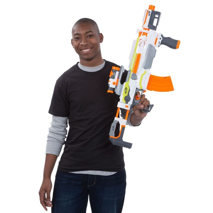 Build your own blaster with the incredible customizations of the Nerf N-Strike Modulus ECS-10 blaster! This motorized powerhouse is going to take your Nerf battling to a whole new level. It launches darts up to 90 feet, but its long range is only the first of its advantages! With up to 30 possible combinations using the included accessories, the Modulus ECS-10 can be almost any blaster you want. For long-distance accuracy, you've got the targeting scope and the Drop Grip. The banana clip…